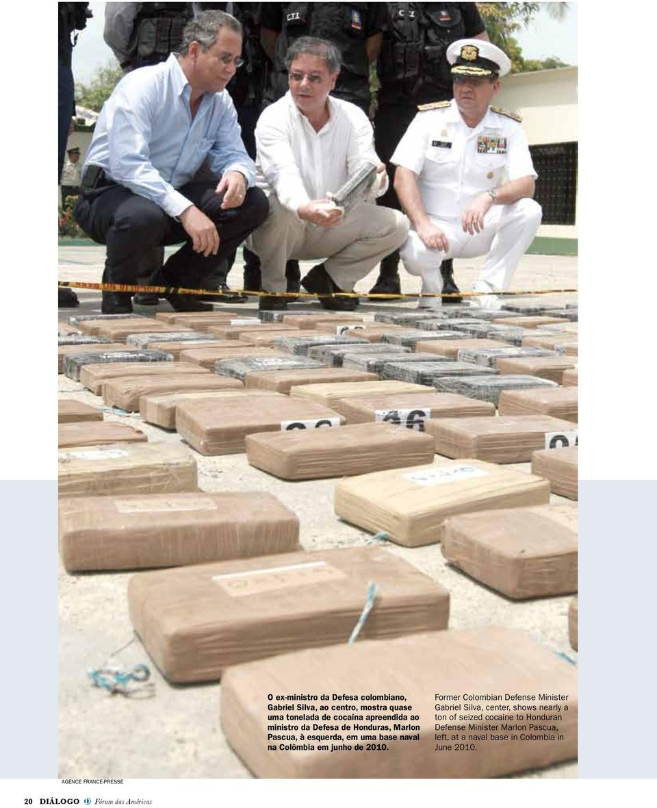 Former Colombian Defense Minister Gabriel Silva, center, shows nearly a ton of seized cocaine to Honduran