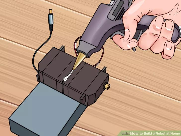 4 Affix the servos with your tape or glue. Make sure that they are solidly attached to the battery pack.